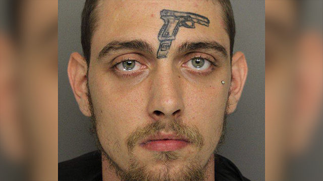 Man with gun tattooed on forehead arrested for unlawful carrying of firearm