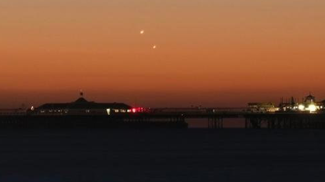 (Source: CNN) Jupiter and Venus pbad over the Palace Pier in Brighton, United Kingdom