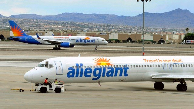 In this May 9, 2013, file photo, two Allegiant Air jets taxi at McCarran International Airport in Las Vegas. (AP Photo/David Becker,File)