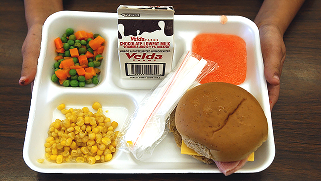 This file photo shows a school lunch consisting of vegetables, whole wheat bread, fruit, and lowfat milk. (AP Photo/Peter Cosgrove)
