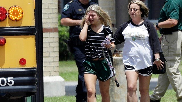 A student cries after returning to Santa Fe High School in Texas to retrieve her belongings May 19. A gunman opened fire inside the school May 18, killing 10 people. (AP Photo/David J. Phillip)