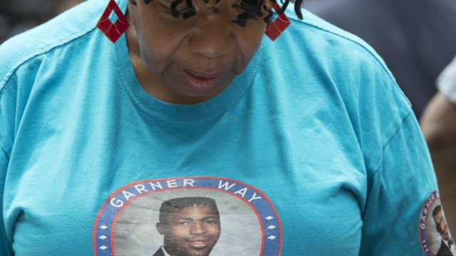 Gwen Carr, whose son Eric Garner was killed by an NYPD officer, wears a shirt displaying a photo of him during a news conference outside City Hall, Tuesday, July 17, 2018, in New York. (AP Photo/Mary Altaffer)