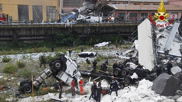 This photo released by the Italian firefighters, cars are seen among the rubble of the collapsed Morandi highway bridge in Genoa, northern Italy, Tuesday, Aug. 14, 2018.   (Vigili Del Fuoco via AP)