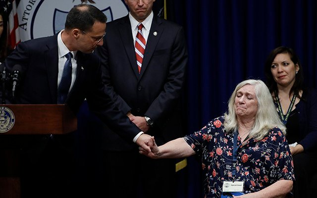 Pennsylvania Attorney General Josh Shapiro holds hands with Judy Deaven who says her son was a victim of sexual abuse by a priest as a boy, during a news conference at the Pennsylvania Capitol in Harrisburg, Pa., Tuesday, Aug. 14, 2018. (AP)