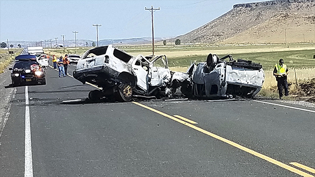 This Monday, Aug. 13, 2018 photo provided by the Oregon State Police shows the scene of a fatal car crash outside Burns, Ore. (Oregon State Police via AP)