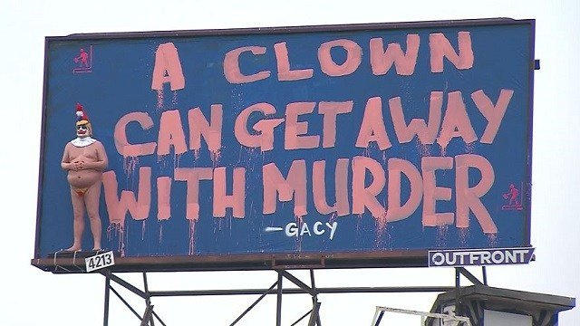 A billboard in Los Angeles displays a statue of President Donald Trump as a naked clown, paired with a quote from serial killer John Wayne Gacy. (CNN)