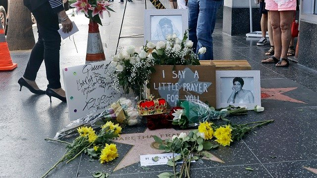 Flowers are placed on Aretha Franklin's star at the Hollywood Walk of Fame, Thursday, Aug. 16, 2018, in Los Angeles. Franklin died Thursday at her home in Detroit. She was 76. (AP Photo/Marcio Jose Sanchez)