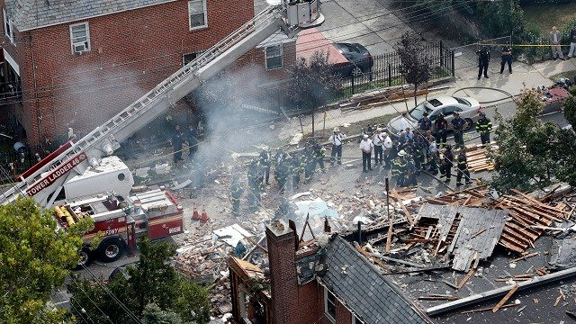 Emergency service personnel work at the scene of a house explosion, Sept. 27, 2016, in the Bronx borough of New York. New York City firefighter Michael Fahy was killed when the residence exploded. (AP Photo/Mary Altaffer)