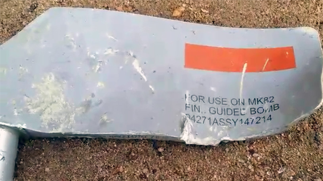 Munitions experts say that the numbers on this piece of shrapnel confirm that Lockheed Martin was its maker and that this particular MK 82 was a Paveway laser-guided bomb. (Source: CNN)
