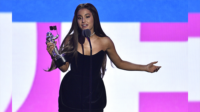 "Ariana Grande accepts her award for best pop video for ""No Tears Left to Cry"" onstage at the MTV Video Music Awards at Radio City Music Hall on Monday, Aug. 20, 2018, in New York. (Photo by Chris Pizzello/Invision/AP)"