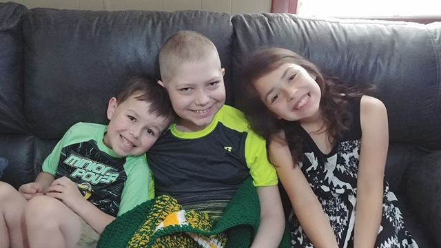 Caleb Hammond (center) wants racing stickers to cover his casket after he dies. (GoFundMe, Hammond Family)