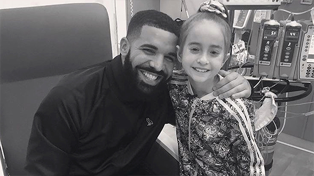 This Monday, Aug, 20, 2018 photo provided by the rapper Drake shows him posing with Sofia Sanchez, at Lurie Children's Hospital in Chicago. (OVO/Drake via AP)