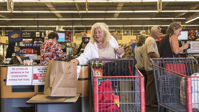 Ocean View resident Beverly Brown stocks up on groceries in preparation for Hurricane Lane at the Ocean Market in Ocean View, on the southwestern corner of the island of Ocean View, Hawaii, on August 22, 2018. (Photo: RONIT FAHL/AFP/Getty Images)