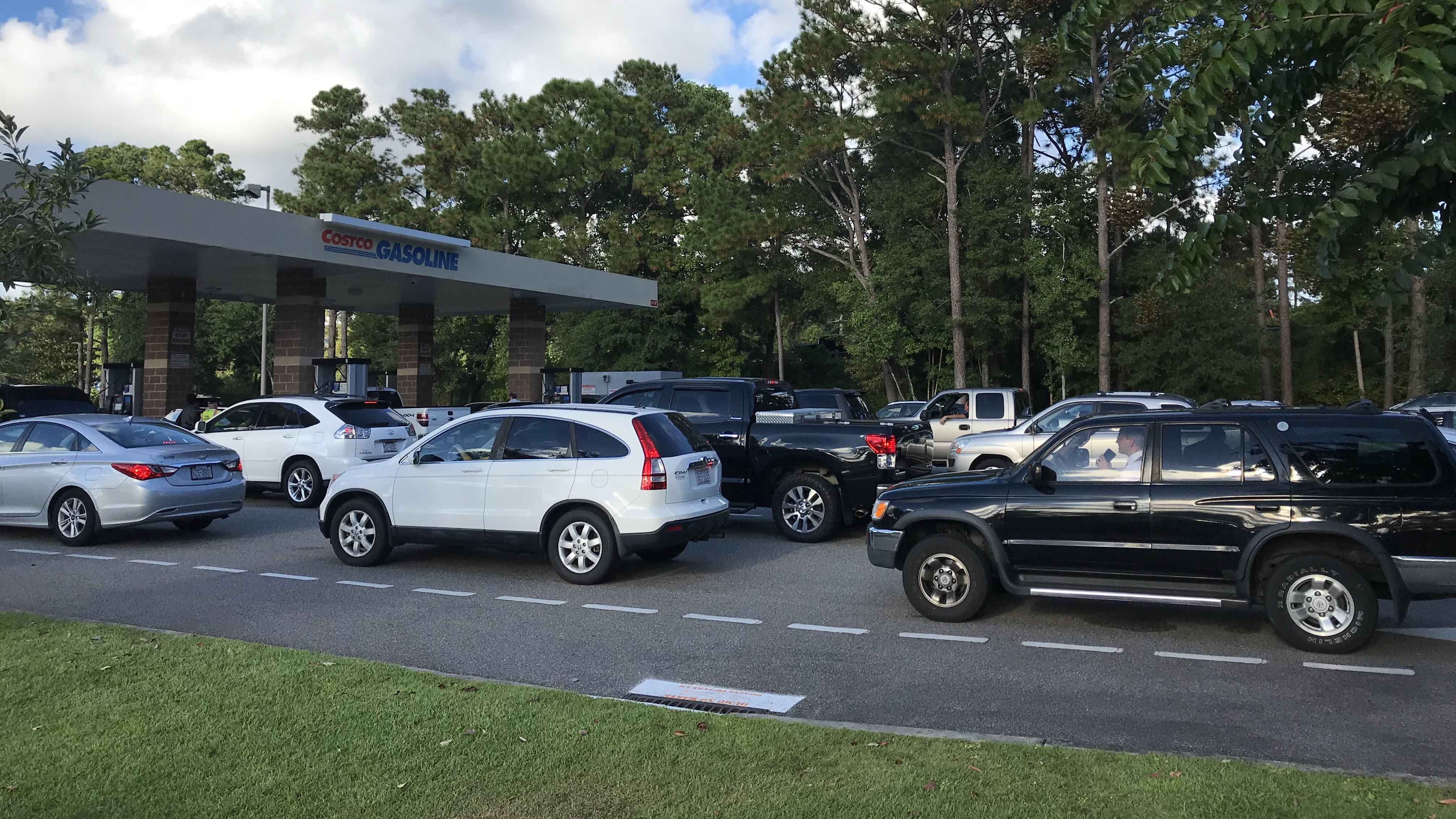 Cars line up outside a Costco to gas up before Hurricane Florence. (Kaylee Hartung/CNN)