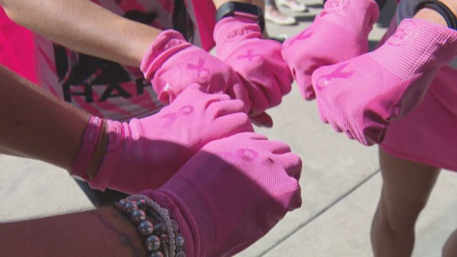 A group of breast cancer survivors came together Saturday morning to pull a 100,000 pound cement pump truck. (KCNC via CNN)